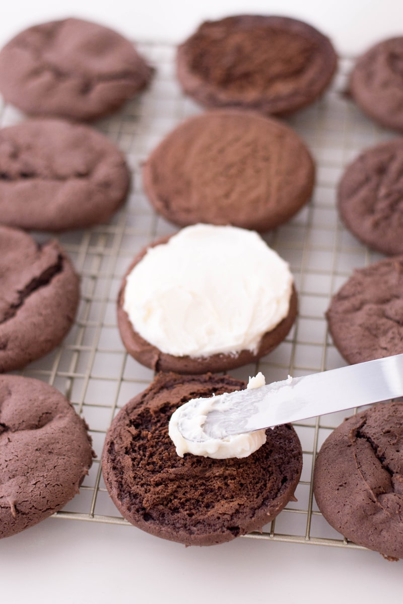 Adding Snowman Whoopie Pies Filling with knife
