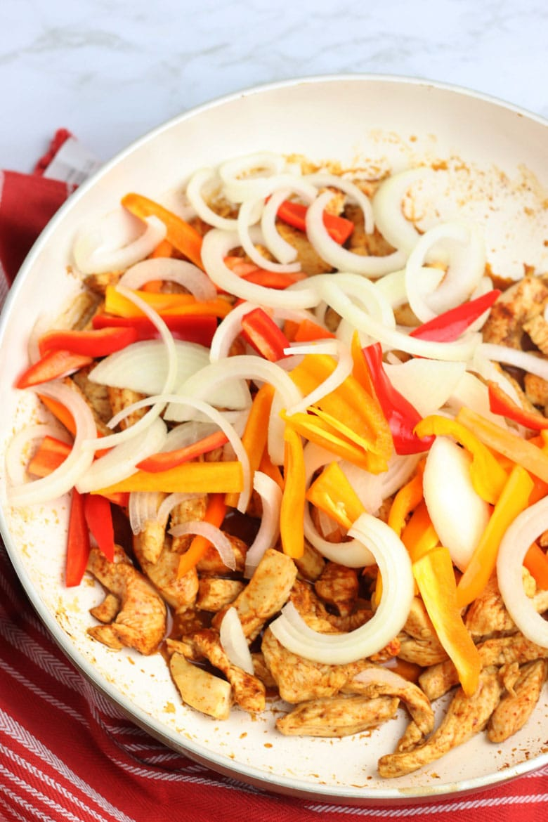 Chicken And Peppers Saute In Pan