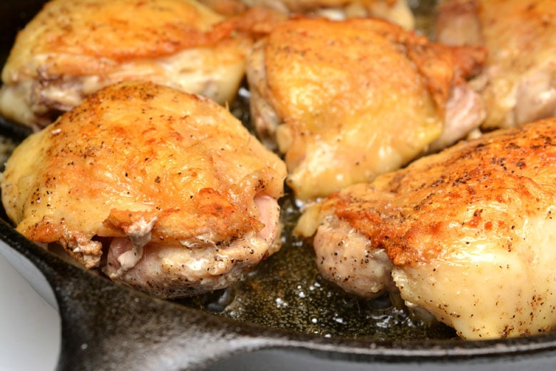 Garlic Roasted Chicken Thighs Browning In Skillet