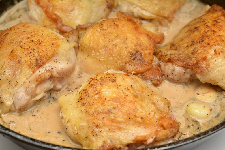 Garlic Roasted Chicken Thighs Parmesan Gravy In Skillet