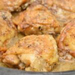 Keto Garlic Roasted Chicken Thighs Parmesan Gravy In Skillet