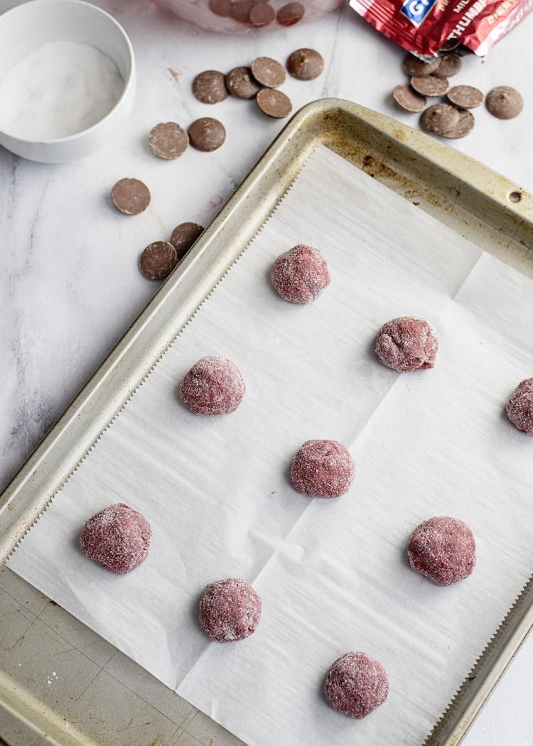 Red Velvet Cake Mix Cookie Dough Balls On Sheet Pan