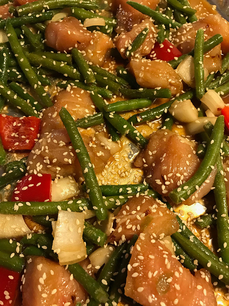 Vegetables on sheet pan with chicken and sesame seed