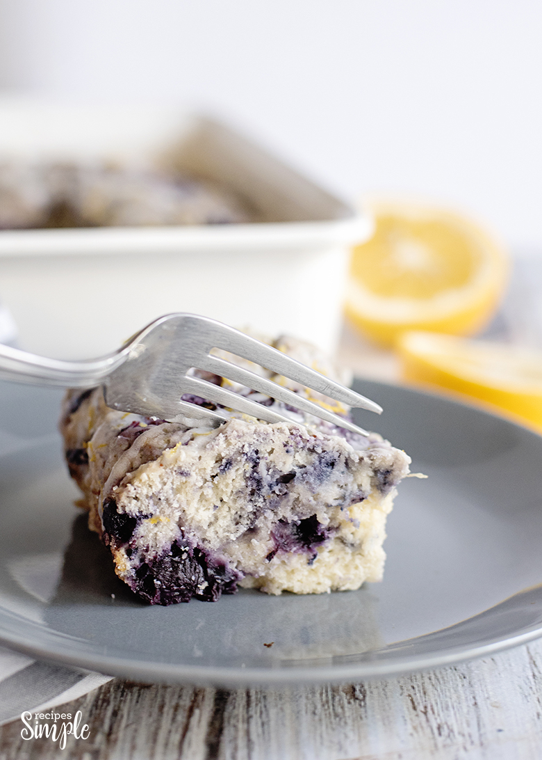 Blueberry Lemon Breakfast Cake on plate with fork cutting a piece