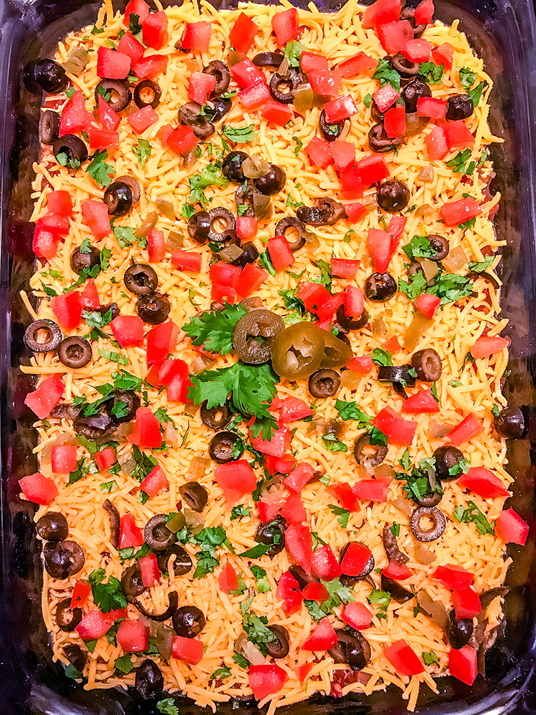 Cheese tomato and black olives layer in glass dish