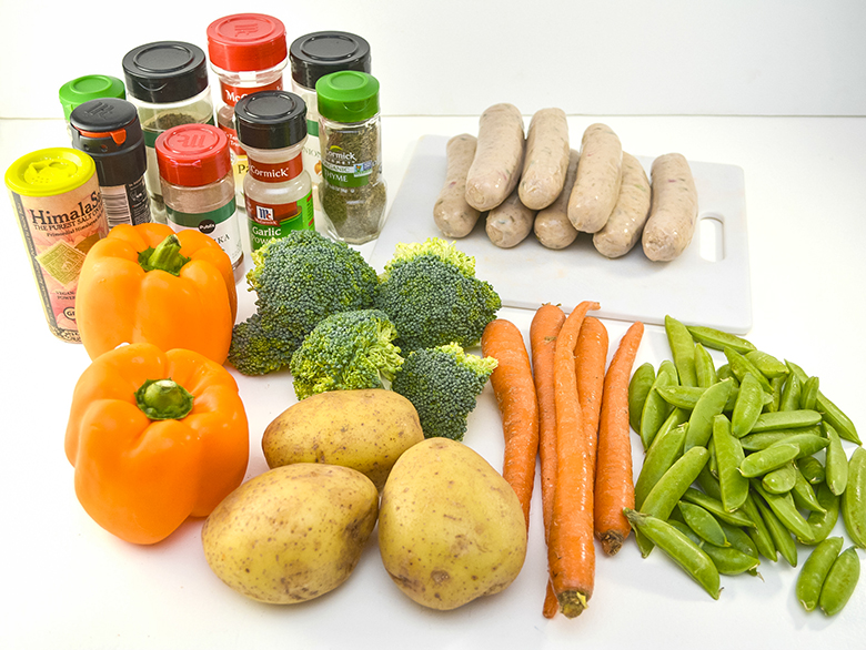 Ingredients vegetables, sausage and spices on counter