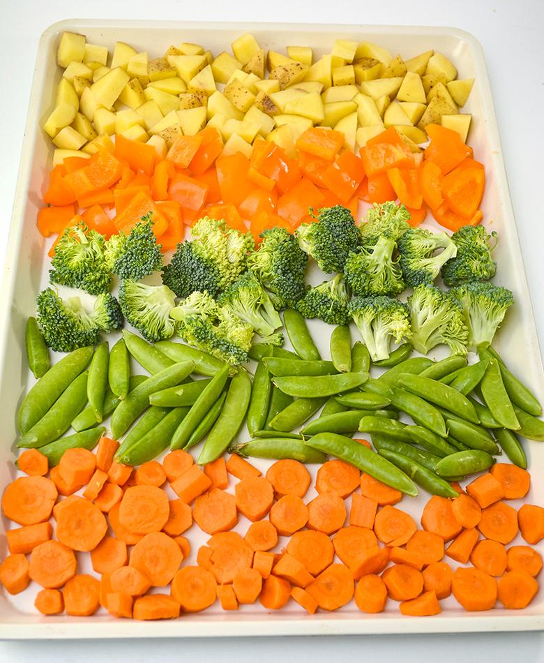 Chopped vegetables on sheet pan