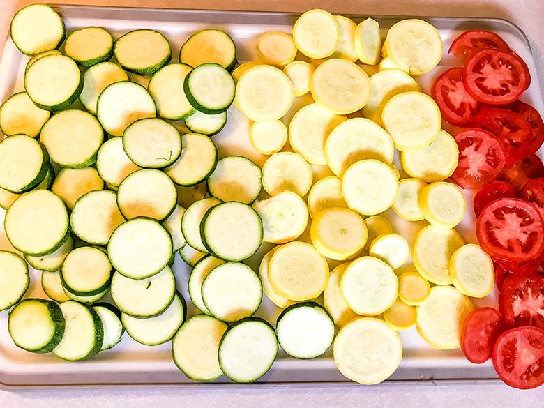 Sliced vegetables on baking pan