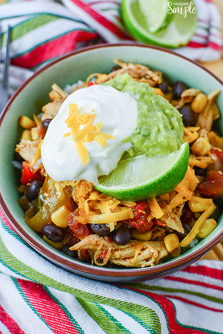 Chicken Burrito Bowl closeup with lime sour cream and guacamole toppings