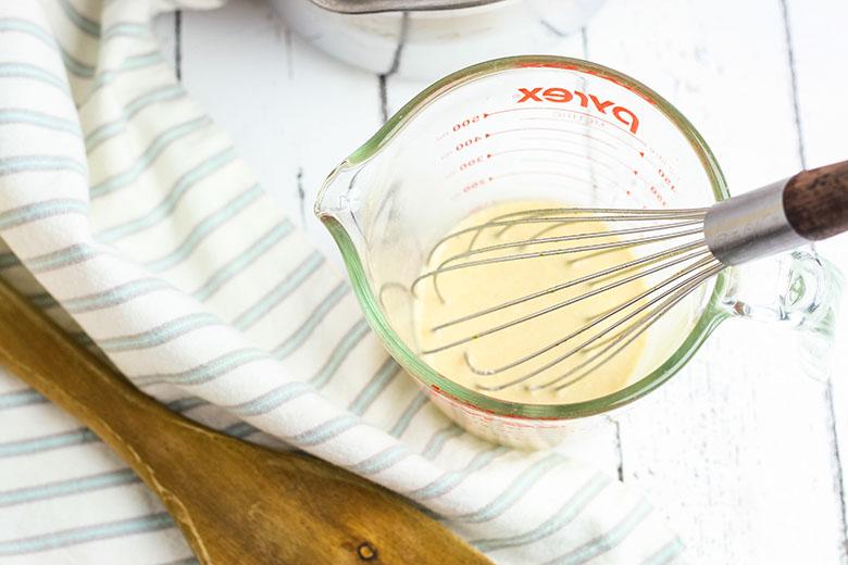 Corn starch mixture in measuring cup to thicken gravy