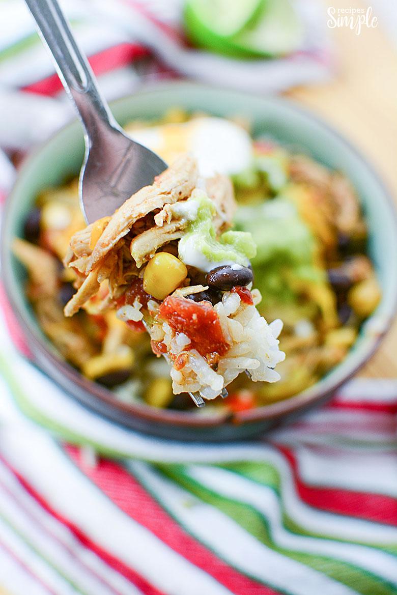 Fork full of chicken burrito bowl ingredients closeup