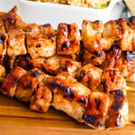 Grilled Pork Kabobs on wooden serving tray