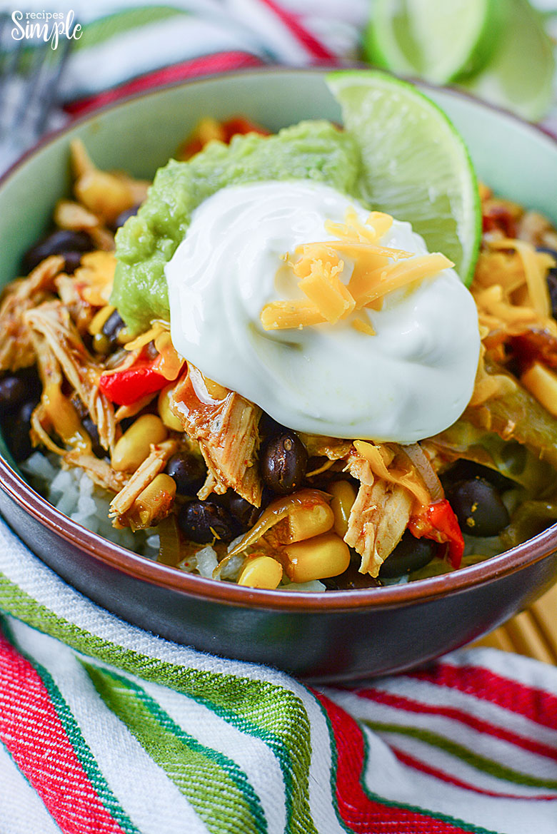 Chicken Burrito Bowl Topped With Guacamole and sour cream