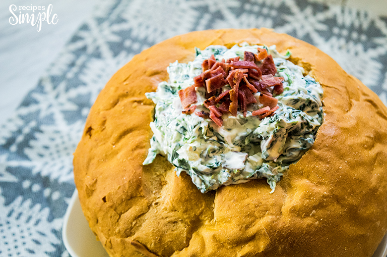 Spinach Dip In Bread Bowl topped with bacon