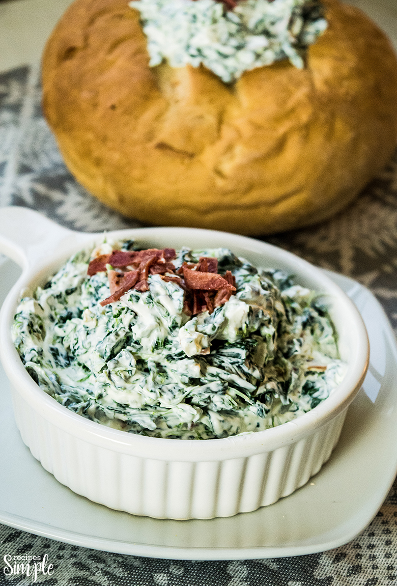 Spinach Dip in White serving bow and bread bowl