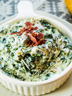Spinach Dip in white serving bowl on white plate