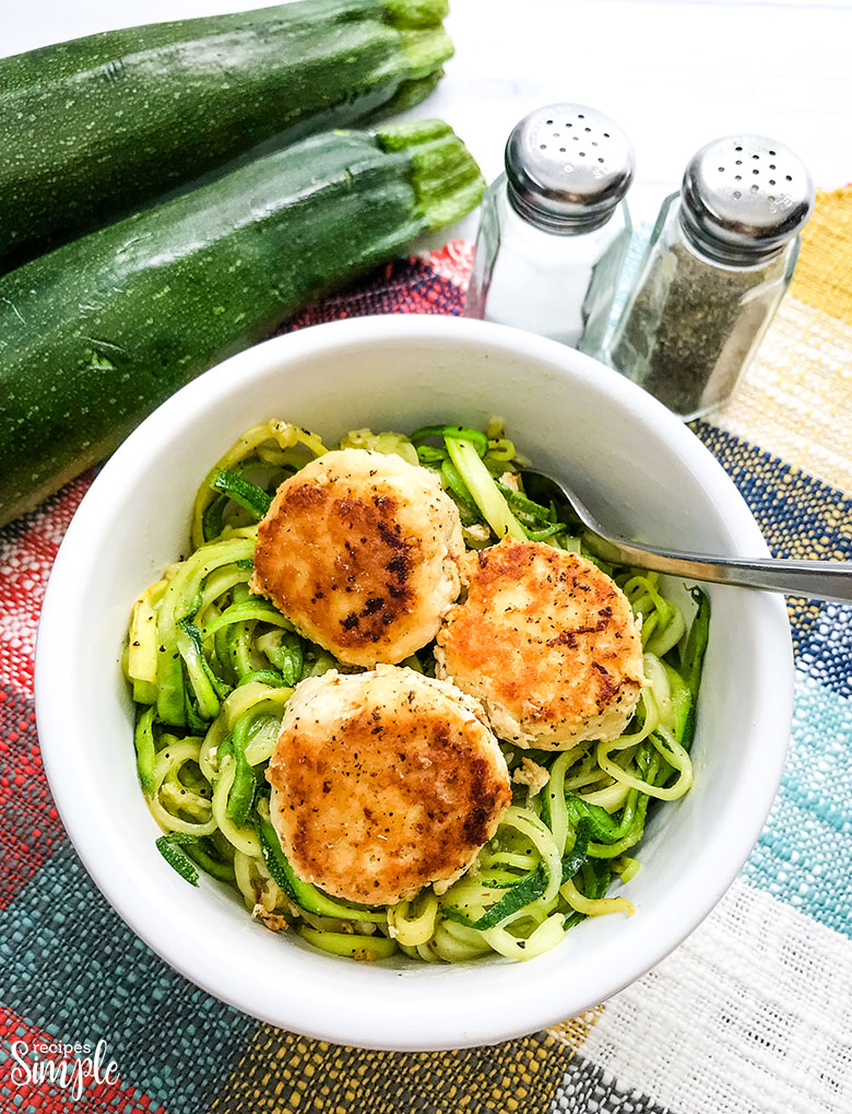 Three Chicken Meatballs over Zucchini Noodles in White Bowl