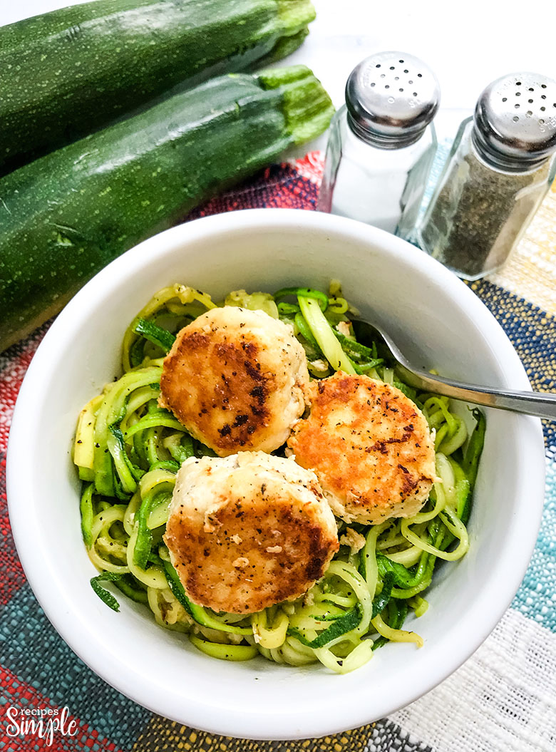 Chicken Meatballs In White Bowl Over Zucchini Noodles