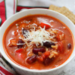 Instant Pot Stuffed Pepper Soup in White Bowl Topped with Cheese