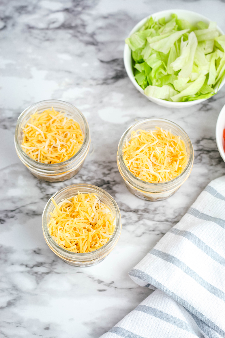 Shredded cheese layer of taco dip in jar
