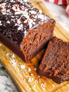 Chocolate Peppermint Pound Cake sliced on wood serving board