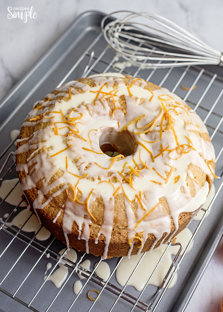Orange Cake On Cooling Rack Drizzled With Icing