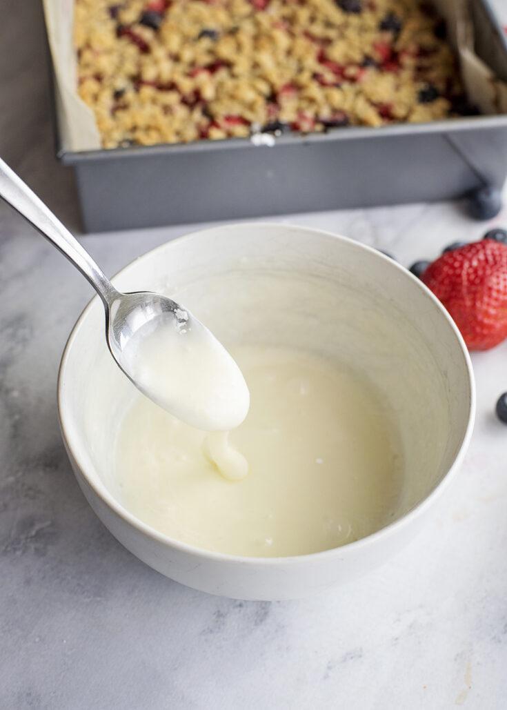Glaze in bowl for berry oat bars