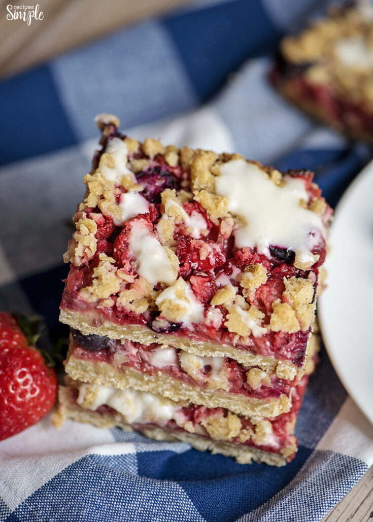Stacked Oatmeal Berry Bars on blue napkin