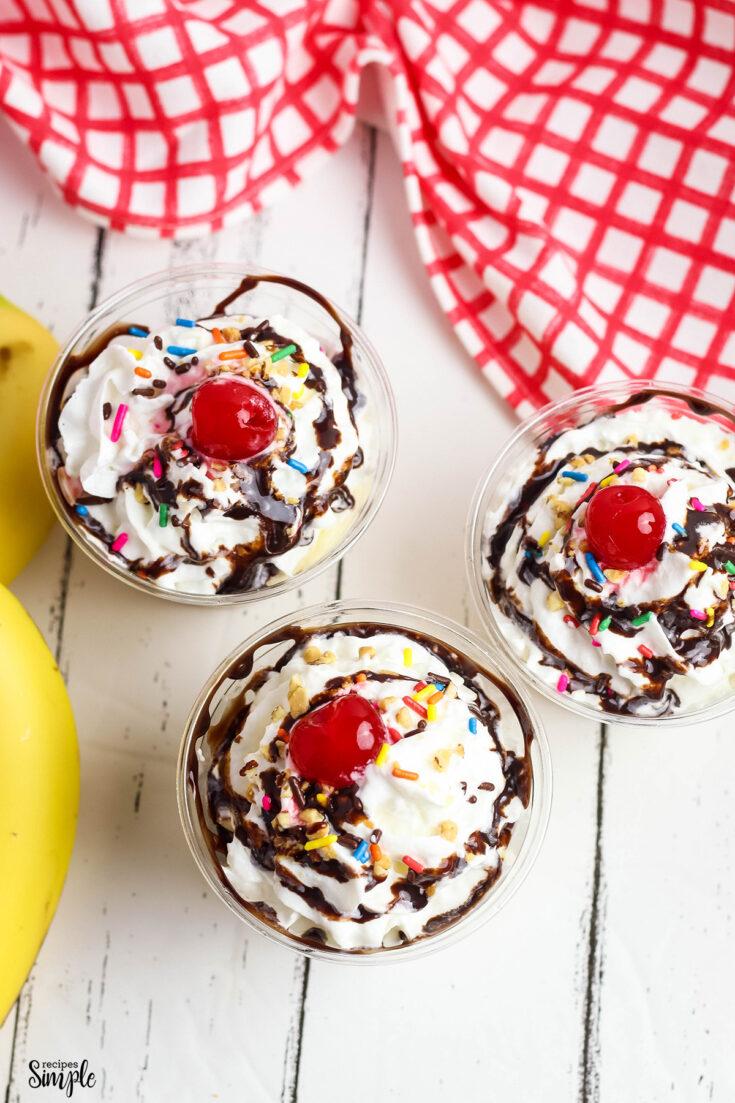 Banana split pudding dessert in clear plastic serving cups