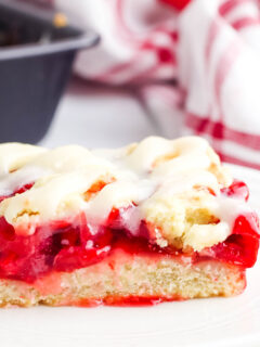 Cherry Pie Bar with Cream Cheese glaze on white plate