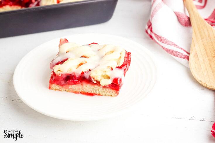 Cherry Pie Bar slice on white plate