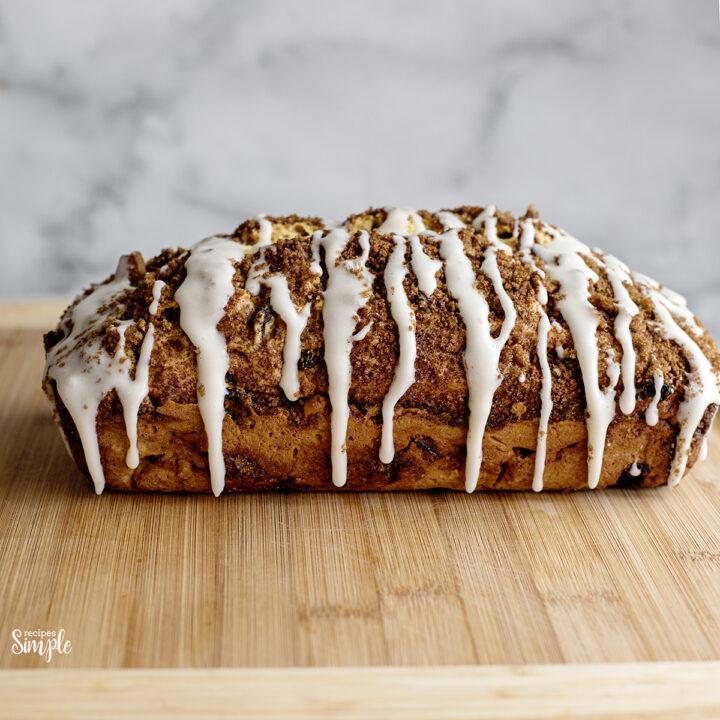 Cinnamon Raisin Quick Bread on wooden serving board