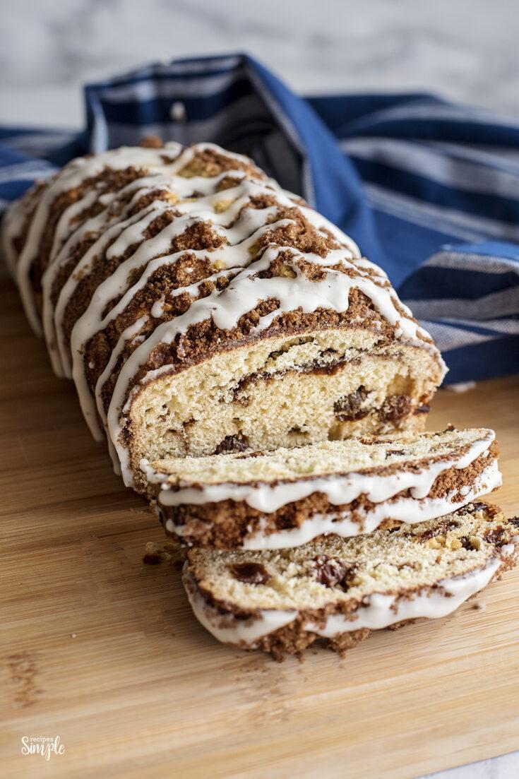 Cinnamon Raisin Quick Bread Loaf Sliced on wooden serving board